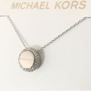 NWT authentic MK Silver tone logo disc necklace